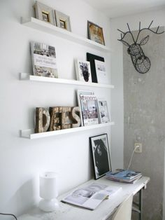 Open Wall shelves entirely in white for books and images