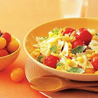 Summer Corn and Tomato Pasta ~ # Salt  # 1 pound bow-tie pasta  # 2 tablespoons extra-virgin olive oil  # 2 garlic cloves, smashed  # 1 pint cherry tomatoes  # 3 ears fresh corn, kernels cut off  # 2 tablespoons unsalted butter  # 1/4 cup fresh basil leaves, torn into pieces