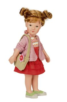 Käthe Kruse Classic Elea Loui-Joe Elea is a playdoll made of high quality hard vinyl. She stands 16 inches tall. She has modern, hand-painted eyes and long Kanekalon hair. Loui-Joe is wearing a summer outfit red dress, pink fleece, light green bag and a pair of green shoes.