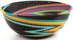 I love these colourful baskets made by the Zulu using traditional techniques in combination with plastic coated wire.