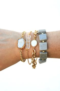 Save $20 purchasing as a set! This stack includes small white druzzy stone bracelet, pearl pixie, forever bracelet, and grey square bracelet on elastic. One of our new favorite stacks!