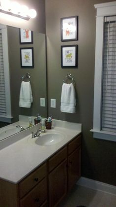 Sherwin Williams paint, Warm Stone. The color is very nice, but it's way too dark, even for all the lights above the sink... If you need  ideas for some accent colors to brighten this up, come on over to http://www.bathroom-paint.net/bathroom-paint-color.php