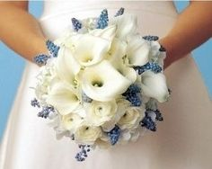 Blue and Calla lily bouquet  Favorite flowers - what about this one? The blue looks nice