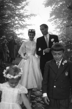 Audrey Hepburn wore a Balmain dress with a petit waist and wide chiffon shoulders for her first marriage to Mel Ferrer.