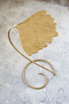 Guilding the ginkgo-shaped side table.