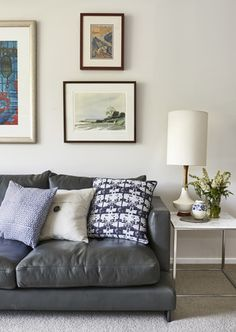 Apartment living - leather lounge, marble side table, linen lampshade
