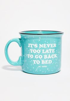 Jac Vanek Go Back To Bed Coffee Mug cuz bed is where your heart is. Stay sippin' with this dope ceramic camper mug that has a speckled glaze and a black halo rim.