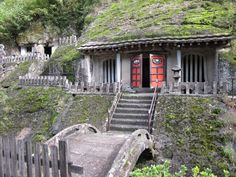 Rakanji Temple, a Sōtō temple in Nakatsu, Oita Prefecture, Japan. The temple stands on the mountainside of Mt. Rakan, the rocky cliff of which has countless mouths of caves. The main gate and the main hall stand directly in the rocky cliff. In the caves, over 3,700 stone Buddhas are enshrined.