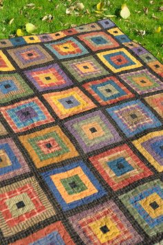 Plaid Log Cabin Finished Quilt by Anka's Treasures Scrap Plaid, common black centre block and the sashings ties everything together. Like the mini block border - photo only