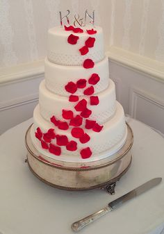 A beautiful red rose petal and silver dot wedding cake