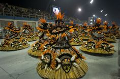 Revelers of 'X-9 Paulistana' samba school perform during the first night of Carnival parades at Sao Paulo, Brazil.