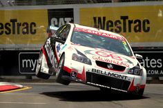 The 2010 Telstra 500 at Sydney Olympic Park. This time some kerb hopping from Tony D'Alberto back when he was driving a Holden. Photo by Craig Coomans ©. Feel free to share, simple ensure you credit the photo to me