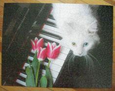 Cat On Keys jigsaw puzzle.