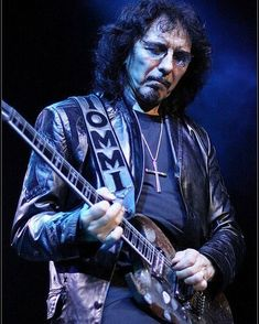 A very special picture of the legendary guitarist Tony Iommi of Black Sabbath, playing live with his legendary Gibson Sg guitar . The World's Number One Online Heavy Metal T-Shirt Store! Visit and Check out our Metalhead Clothing and Satanic T-Shirt Stores; www.HeavyMetalTshirts.net  • #metal #metalmusic #metalheads #metalhead #headbang #headbanger #longlivemetal #metalband #headbangers #heavymetalband #heavymetalfans