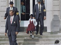 "Ruby Bridges escorted by U.S. Marshals to attend an all-white school, 1960.""Color has the power to bring life back to the most important moments"""