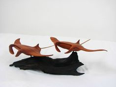 Carved #manta pair in #mahogany on #driftwood base #mantawoodcarving #mantacarving #mantaraycarving #mantaraywoodcarving