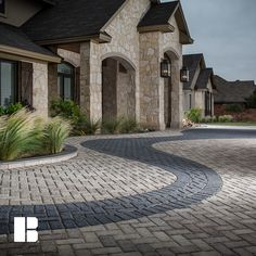 Create a dramatic entrance to your home through the use of design accents. You can do this by using multiple paver styles, or simply by using contrasting colors, shapes and/or laying patterns of the same paver style. Brick Driveway, Driveway Design, Brick Paving, Concrete Pavers, Paving Stones, Paver Patterns, Paving Pattern, Outdoor Spaces, Outdoor Living