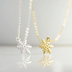 Tiny Snowflake Necklace by Olive Yew. Silver or gold add a delicate touch.