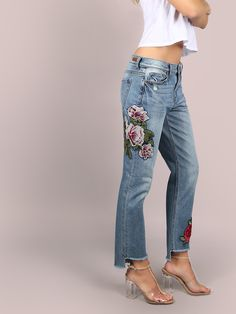 """Move on from the boyfriend style jeans to the new girlfriend jeans. Featuring girlfriend styled jeans with a light washed look, feminine floral patch work, classic five pocket design, front button + zip closure and a cropped dip hemline. Jeans measure 37.1"""" in. from waist to bottom hem. Team it with a white bardot crop top and blush heels. Model is pictured in a size 3. #denim #MakeMeChic #style #fashion #newarrivals #winter16"""