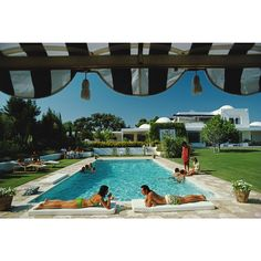 """Slim Aarons """"Poolside in Sotogrande"""" Photograph A print hand-selected from American photographer Slim Aarons' classic collection. August 1975—Bathers round a pool in Sotogrande, Spain.  Each photograph is printed from scans of the original negative then mounted on aluminum and faced with museum quality Plexiglas."""