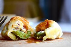 Puff pastry jalapeno poppers...(You must scroll to very bottom of page for recipe) Looks awesome..So gonna try this one!