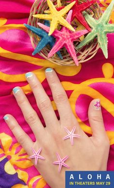 Get beach ready with a cute, Aloha-inspired manicure! Simply paint nails light tan, then a wave of white, then top your nails off with ocean blue, it's pretty easy! I added a pink starfish to my thumbnail for a pop of color. Sponsored by Aloha Movie, in theaters May 29th.