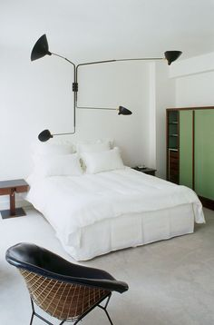 swing arm lamp as headboard
