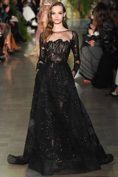 Elie Saab Alta-Costura Paris 2015. I definitely see Olivia Wilde at the Oscars in this dress; I'd love her hair in a beachy bob that went just a few inches above the shoulders. I'd add a touch of color in the clutch and earrings, although I would definitely do a dark color; maybe a dark red/purple