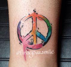 Watercolour peace tattoo