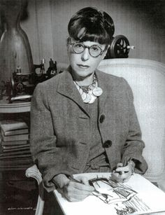 This was one of my earliest pins.  Edith Head is perhaps better known for dark/black horn-rims (or smoked lenses) and a slightly different hairstyle.  This, which to my eye is slightly more attractive and different than other photos of Head, also shows her (ostensibly) at work, which I liked to see.