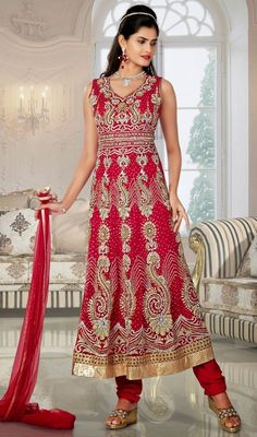 Reveal the glamour in you by draping this red embroidered tissue net Anarkali suit. The incredible dress creates a dramatic canvas with terrific lace, patch, resham and stones work. #NewDesignerDress