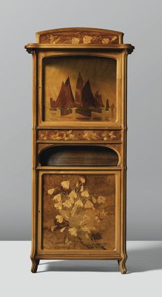 A WALNUT CABINET WITH FRUITWOOD MARQUETRY INLAY BY EMILE GALLÉ, CIRCA 1905.