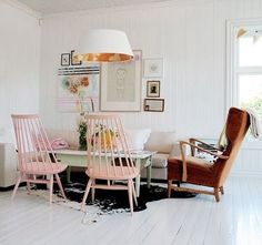 Cow and pink wooden chairs