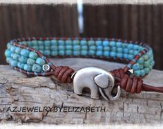 SEED BEAD LEATHER WRAP BRACELET/ BEADED SINGLE WRAP BRACELET.  THIS BRACELET IS MADE WITH TURQUOISE PICASSO SEED BEADS.  ONE OF A KIND DESIGNING ORIGINAL SINCE ( FEBRUARY 18 20016 ) YOU HAVE YOUR CHOICE OF MANY BUTTONS. IF THERES AN ITEM WITH A PARTICULAR BUTTON YOUD LIKE ON ANOTHER LEATHER WRAP BRACELET, PLEASE LET ME KNOW.  PLEASE MEASURE YOUR WRIST SIZE BEFORE YOU ORDER THANK YOU FOR STOPPING BY, PLEASE CONTACT ME IF YOU HAVE ANY QUESTIONS.  PLEASE READ MY SHOP POLICIES BEFORE PURCHASE…
