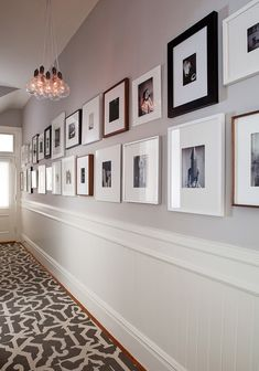 Gallery wall along a long hallway by Senalee Kapelevich of SVK Interior Design (via Desire to Inspire).