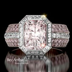 The Frame of Fire engagement ring with a light pink center stone and two pink sapphire bookend bands #diamondjewelry #blazecutdiamonds www.bezambar.com