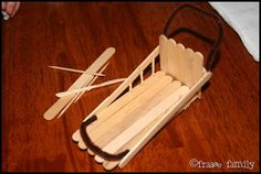 dogsled from popsicle sticks--I had to make it, but the girls love it!