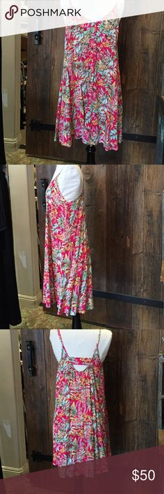 """Pink Stitch swing dress Pink Stitch swing style dress with adjustable shoulder straps. Measures 26"""" from bottom of V neck to bottom hem. 65 % polyester, 35% rayon. Very light and airy. Cute Hawaiian print Pink Stitch Dresses Mini"""