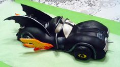 I made this Batmobile for my grandson's 5th birthday cake.  It was made out of RKT, fondant and gumpaste.  By Fun Fiesta Cakes.
