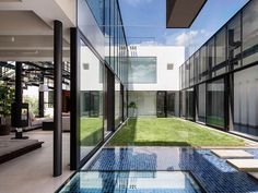 Glass Walls, Garden, Water Feature, Bright Contemporary Home in Tokyo, Japan