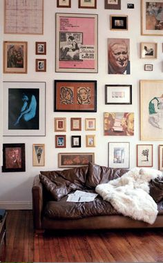 A salon-style approach suggests a sophisticated European vibe that never goes out of style. Perfect for large collections, the gallery wall owes its success to the mix but it's not as random as it may appear. ------------ #gallery #wall #home #decor #picture #frames #custom #framing #diy