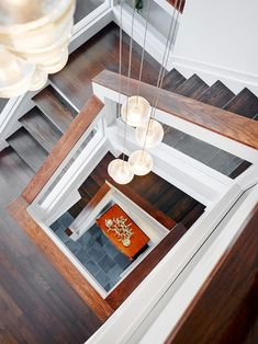 Picturesque Three-Storey House Building with Natural Landscape: Artistic Ornament On Wooden Cabinet View From Above The Stairs With Modern Stylish Pendant Lighting Design Ideas ~ FreeSharing Architecture Inspiration Staircase Handrail, Wooden Staircases, Staircase Design, Stairways, Stair Railing, Interior Design Boards, Interior Stairs, Decor Interior Design, Unfinished Basement Ceiling
