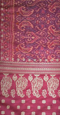 Close up section of a jembatan pengantin also known as a bride's bridge. Old silk ikat weaving with gold supplementary weft songket. www.kulukgallery.com  The entire textile is more than 2.5 meters long and hard to photograph.