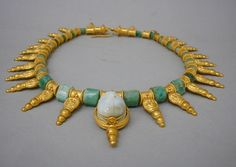 Necklace by Castellani, Italy, 1860-1862; agate intaglio, cast, stamped and chased gold with emerald