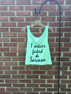 Funny gift for her, Workout tank, sarcastic gift, crop top, girlfriend gift, gym, sarcasm shirt, yoga clothes, work out, fitness, sarcasm  About the design: ©RCTees 2016 My husband Mark created the fun and sarcastic, I never faked a sarcasm design and hand prints it in black ink on a so-soft, , super lightweight, 65% polyester, 35% viscose, Bella + Canvas, ladies flowy, loose fit, boxy, tank style, crop top.  ♦ Wash in cold water, gentle cycle, hang dry  Sizes run a bit large, please check…