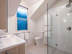Interesting bathroom with raked ceiling. Corner frameless shower in Claralite. Raked Ceiling, Frameless Shower, Corner Bathtub, Showers, Bathroom, Washroom, Slanted Ceiling, Bath Room, Shower