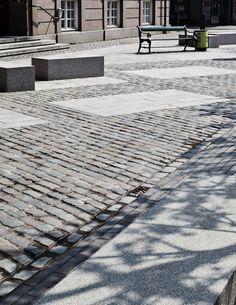 Granite benches and bike lane in Vartov Square, Copenhagen by Hall McKnight…