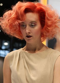This hair color would photograph really well for spring. TIGI pink copyright colour