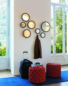 A set of three miniature mirrors with integrated chrome plated coat hooks for a multipurpose modern mirror