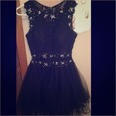 Beautiful black short prom dress Worn once to my winter formal! In perfect condition! Very beautiful dress that I purchased from prom girl! Sweetheart neckline with lace back and beautiful jeweled details! The middle is a sheer mesh as shown in the picture! Sure to turn heads! Dancing Queen Dresses Prom